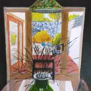 Green Vase On Glass Topped Table